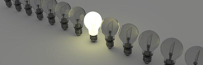 one lit lightbulb in a row