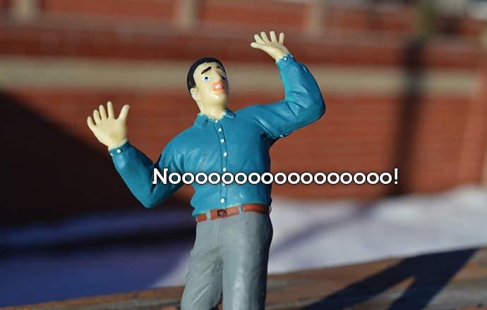 figurine of man in a panic screaming Noooo