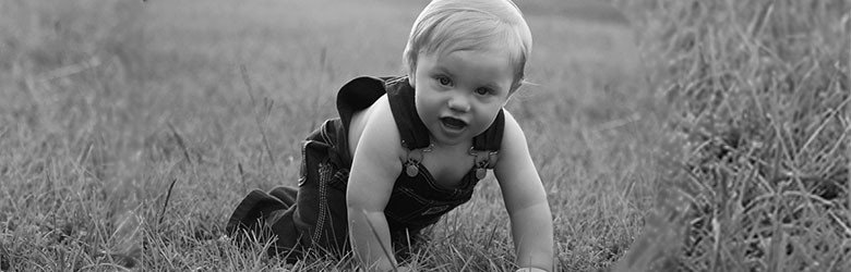 baby crawling in field