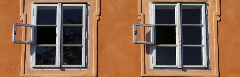 A photograph of two windows on a wall.