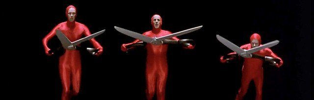 guys in red bodysuits with scissors