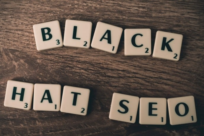 scrabble tiles that say black hat seo