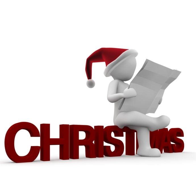 santa sitting on christmast letters reading