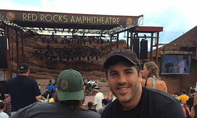 A photograph of Forrest Dombrow at Red Rocks Amphitheatre.