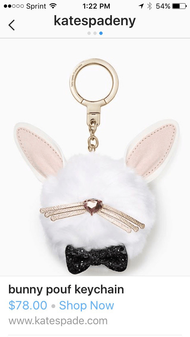 Kate spade Instagram photograph of bunny pouf keychain. Below the photograph is the product title, price, Shop Now link, and Kate Spade U R L.