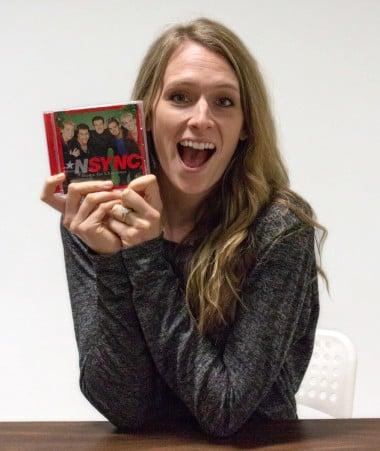 Mandy Mangold holding an NSync C D.