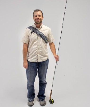 Devon Cox holding a fishing pole.