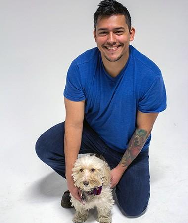 Cear Tellez with a small dog.
