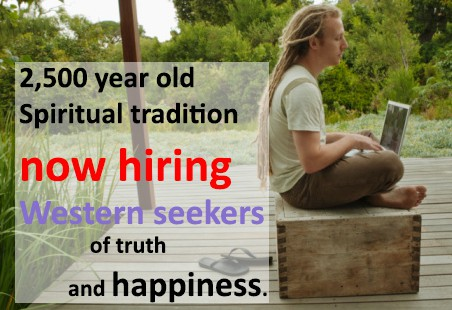 A photograph of a person on a laptop sitting outside on a box. Text states: 2,500 year old Spiritual tradition now hiring Western seekers of truth and happiness.