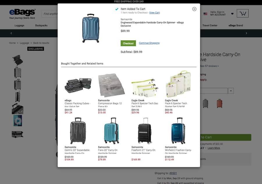 """Ebags product added to cart modal screenshot. At the top, a section titled """"Item added to cart"""" followed by the item: a Samsonite suitcase. Below a section titled: """"Bought together and related items"""" featuring 8 items with a photograph, name and price."""