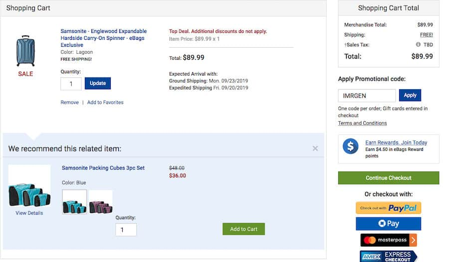 """Ebags pre-checkout screenshot. At the top left a section titled shopping cart containing a Samsonite suitcase. Below, a section titled """"We recommend this related item:"""" followed by Samsonite Packing Cubes. On the right is the shopping cart total."""