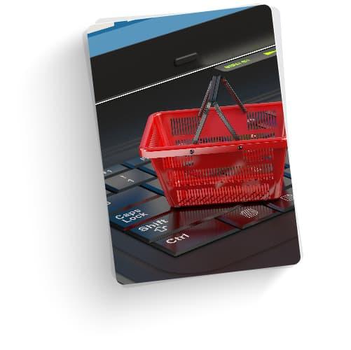 shopping basket on keyboard showing ecommerce SEO
