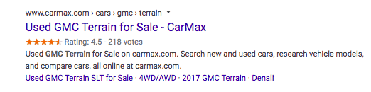 A Google search result for CarMax. The title of the page is followed by a rating along with the number of votes.
