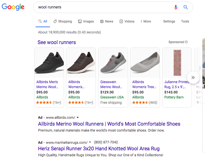 Google search results for wool runners. Text at the top of the results states: See wool runners. Beneath is a horizontal row of products with an image of the product, name, price, website and rating with the option to scroll. Three of the first four results are for the Allbirds brand. Beneath, the first Ad text result is Allbirds.
