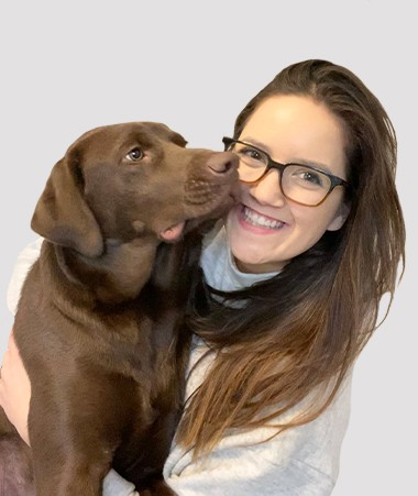 Estelle Lampela with a dog.
