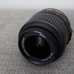 A photograph of a Nikon lens.