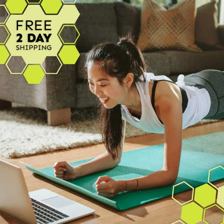 A photograph of a smiling woman in plank position on a yoga mat and looking at a laptop screen. Text states: Free 2 day shipping.