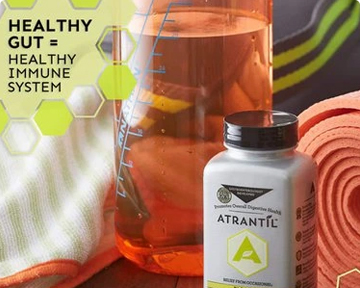 A photograph of an Atrantil bottle with a glass container with measurement lines and a yoga mat in the background. Text states: Healthy gut equals healthy immune system.