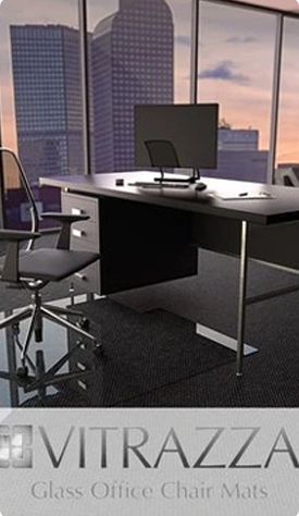 A photograph of a glass chair mat in an office setting. Logo: Vitrazza Glass Office Chair mats.
