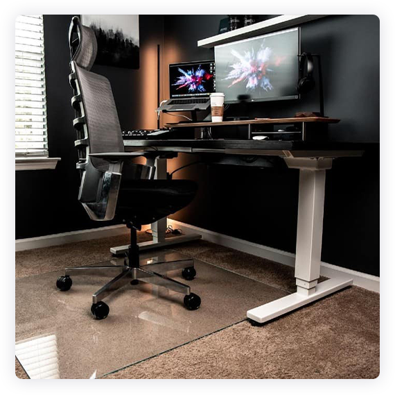 A photograph of a glass chair mat in a home office setting.